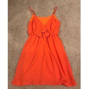 Oranges dress with bow